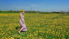 Blond lady is showing us beautiful yellow meadow. Stock Footage