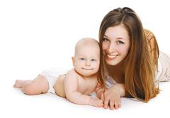 Portrait of young smiling mom and sweet baby together Stock Photos
