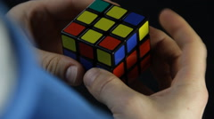 Close Up Shot of solving Rubik's Cube puzzle - stock footage