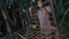 Man Opens Cage GUAM, USA- CIRCA February, 2011 Stock Footage