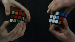 Close up Top View of Two People Solving Rubiks Cube Stock Footage