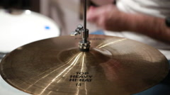 Drummer plays his drums, high hat cymbal CU - stock footage