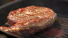 Ribeye steak marbled beef smokes tasty slow motion Stock Footage
