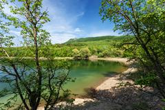 Stock Photo of Lake in the forest. Sunny day in summer. Crimean mountains