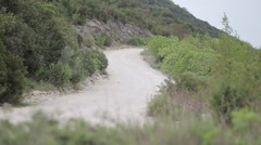 Dirt trail road on island - stock footage