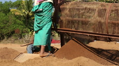 Portrait of boy moving wheel of the soil processing machine. Stock Footage