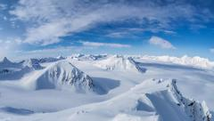 Clouds over the Arctic glaciers and mountains - Svalbard Stock Footage