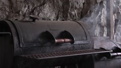 Stock Video Footage of Old barbecue cylindrical