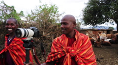 African tribesman holds a modern camera Stock Footage