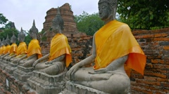 Video 1080p - Long row of ancient, identical, hand-carved Buddha sculptures, Stock Footage