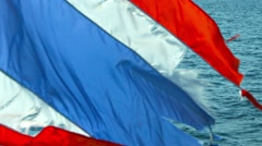 Stock Video Footage of Tattered Thai National Flag on the Stern of a Tour Boat in Thailand