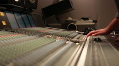 Audio Engineer adjusting knobs on console, low angle Stock Footage