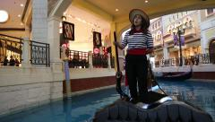 Girl gondolier steers the boat and sings a voice Stock Footage