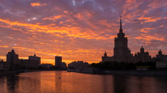 Russia, Moscow, Hotel Ukraine, Moskva river, sunset T/L Stock Footage