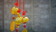 Gold-Colored, Asian Lantern-Style Ornaments Blowing in the Breeze Stock Footage