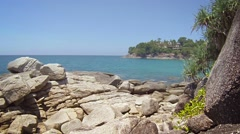 Overlooking a Beautiful, Rocky, Tropical Beach on a Sunny Day Stock Footage