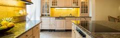 Granitic countertop in kitchen Stock Photos