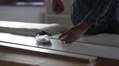 Furniture, home and moving concept - close up of male hands assembling furniture Stock Footage