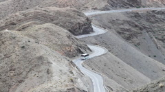 Winding road along a cliff - stock footage