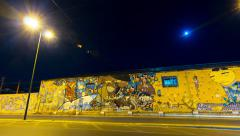 Stock Video Footage of 4k Athens city street at night, urban graffiti on wall motion pan timelapse 25p