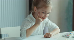 Child drawing a bird. Girl looking at camera Stock Footage