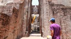Wat Si Chum, Ancient buddha temple. Sukhothai Historical Park, Thailand Stock Footage