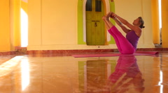 Woman doing yoga in ashram. Stock Footage
