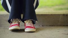 Young Woman Tapping Feet and Waiting Stock Footage