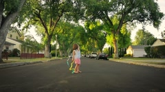 Happy girl dancing with ribbon on beautiful street, trees background Slow motion - stock footage