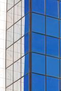 Modern building exterior with glass and metallic facade Stock Photos