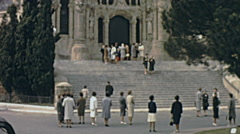 Barcelona 1964: visitors in front of Sagrat Cor Stock Footage