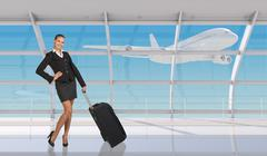 Smiling flight attendant in airport - stock photo