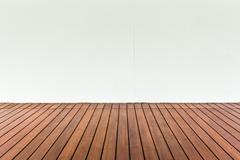 Wood plank floor and white wall, can use as vintage background Stock Photos