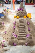 Sand pagoda ceremony, Cultural activities including sand sculpture for Songkr - stock photo