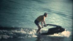 (Super 8 Vintage) Man Attempting to Ride JetSki Fail Stock Footage