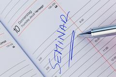 entry in the calendar: seminar - stock photo