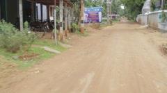 Drive through village Stock Footage