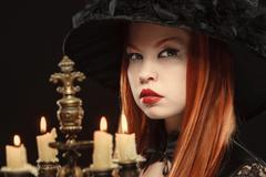 Gothic girl with candles Stock Photos