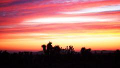 Time Lapse of Heavenly Sunrise over Desert Landscape Stock Footage