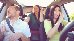 Cool women and man dancing slow music in car while driving in summer Arkistovideo