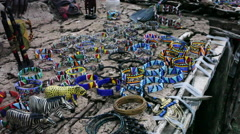 African tribe sells jewelry and souvenirs Stock Footage