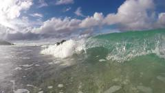 Wave breaking onto tropical beach and splashing on lens, slow motion Stock Footage