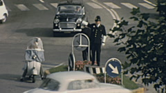 Italy 1963: traffic officer working on the street Stock Footage