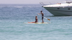 Children paddle boarding - stock footage
