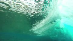 Slow motion underwater view of surfer taking off on wave Stock Footage