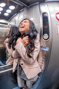 woman with claustrophobia in elevator - stock photo