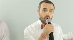 Close-up of performance of singer as part of of the musical group in the studio Stock Footage