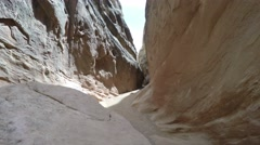 Woman moving inside a slot canyon Stock Footage