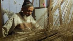 Varanasi, india, indian weaver at work Stock Footage