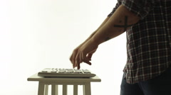 Man DJ masterly playing on an electric music controller Stock Footage